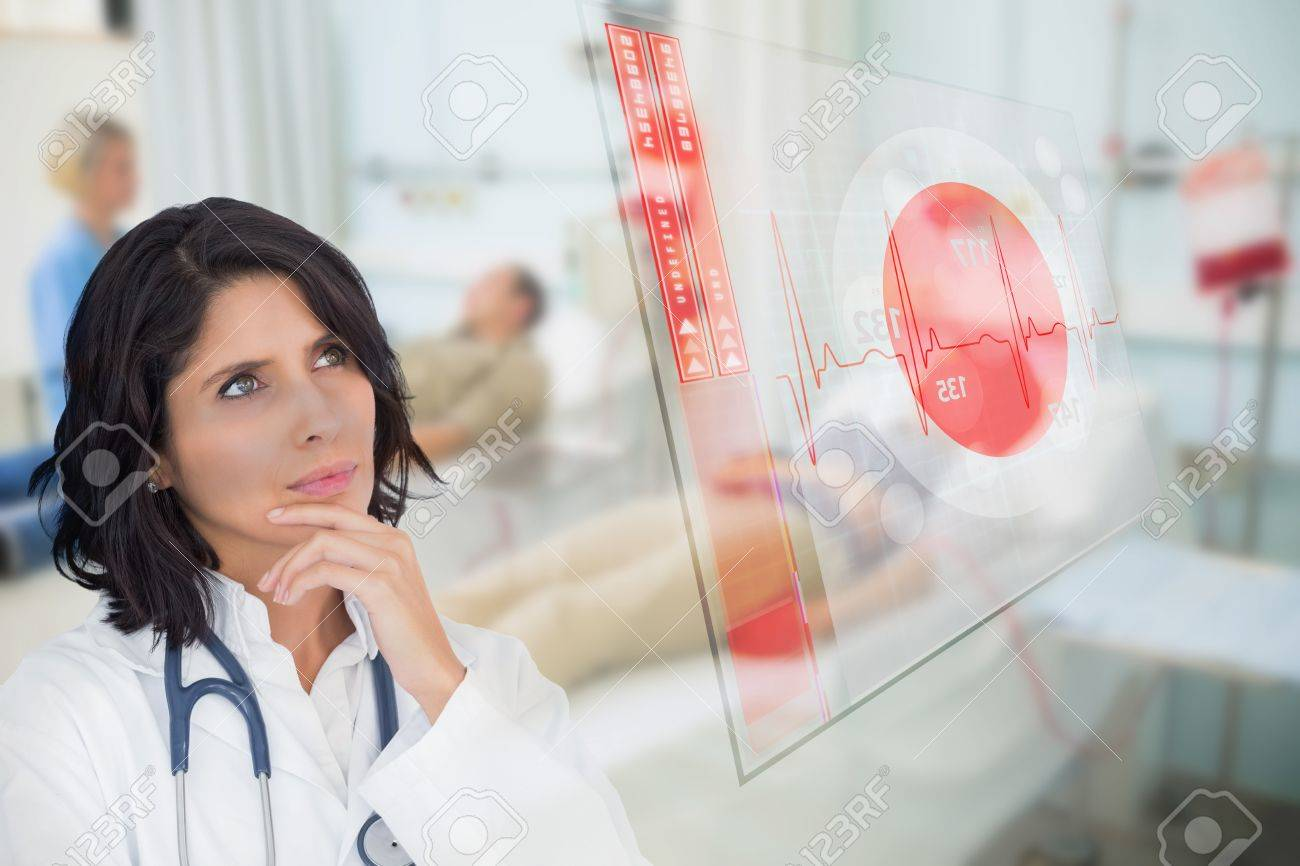 Doctor looking up at screen showing red ECG data in hospital ward Stock Photo - 18132214