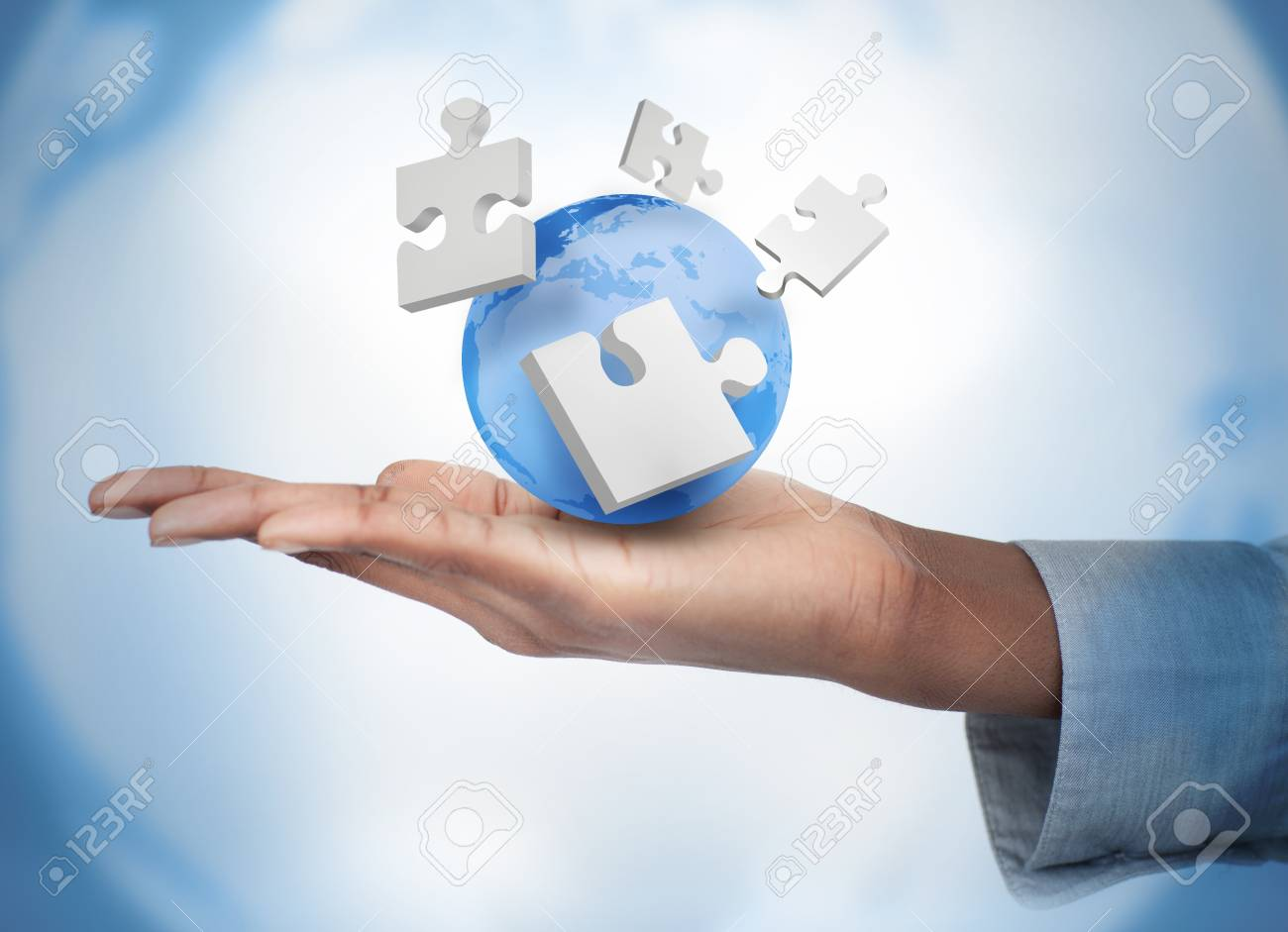 Hand with digital puzzles and a globe against a digital background Stock Photo - 18132249