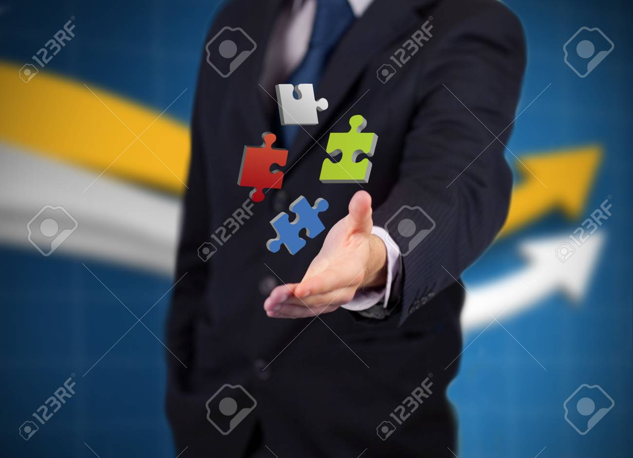 Businessman with digital coloured puzzles against a graph Stock Photo - 18132096