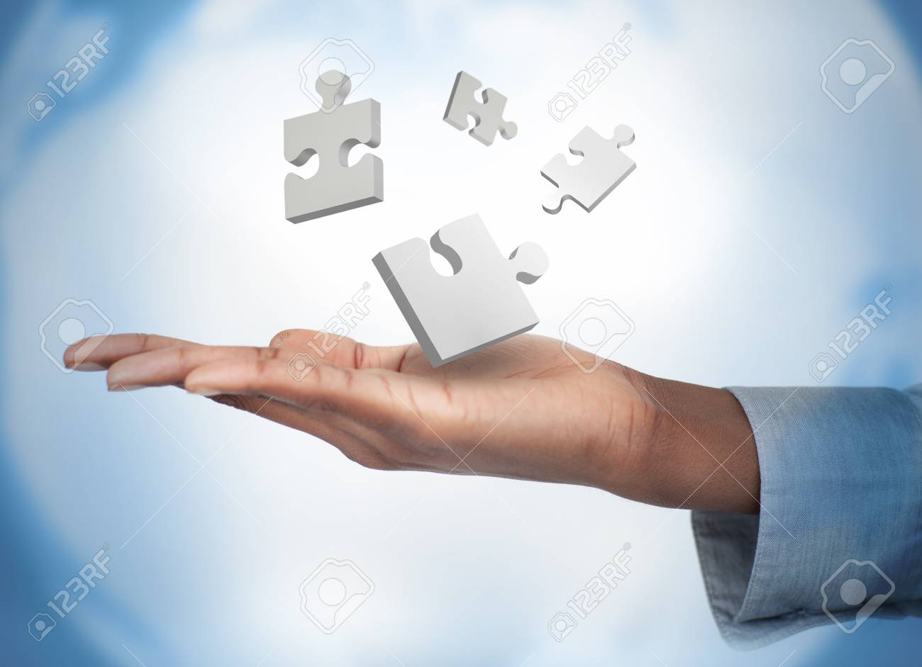 Hand with digital white puzzles against a digital background Stock Photo - 18132209
