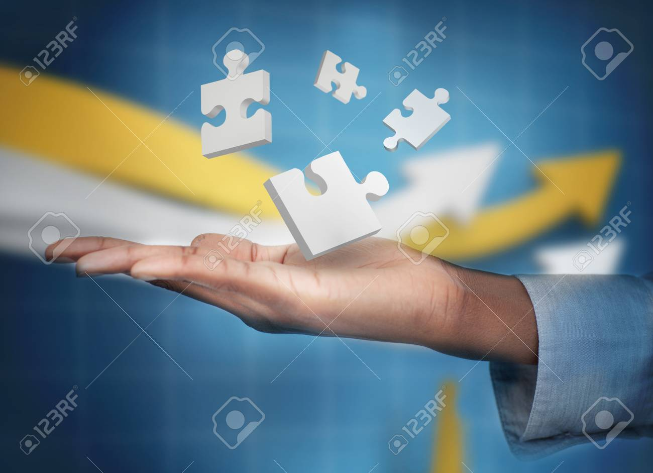 Hand with digital white puzzles levitating against a digital background Stock Photo - 18132196
