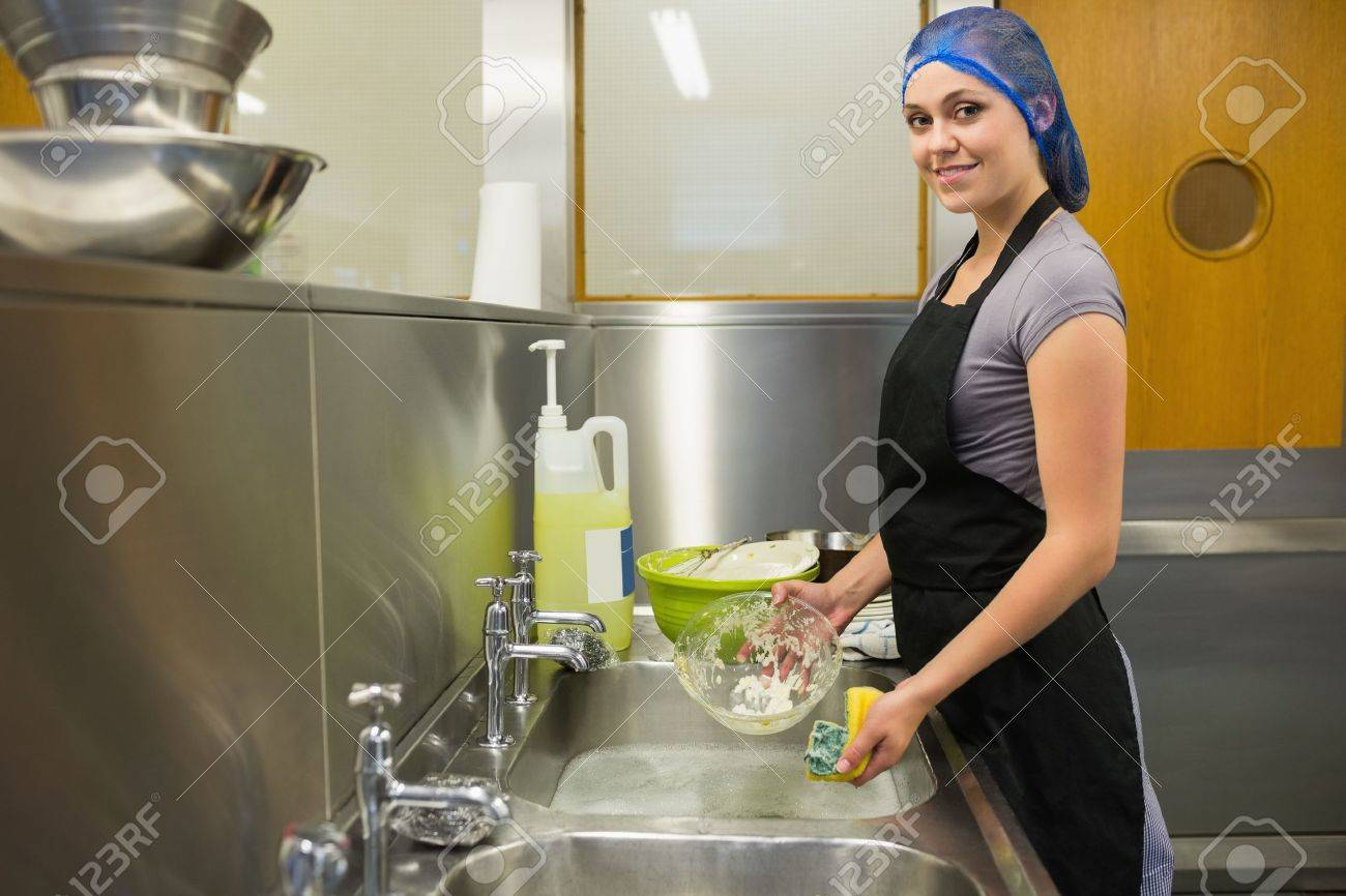 Smiling woman using a sponge in the restaurant Stock Photo - 20517446