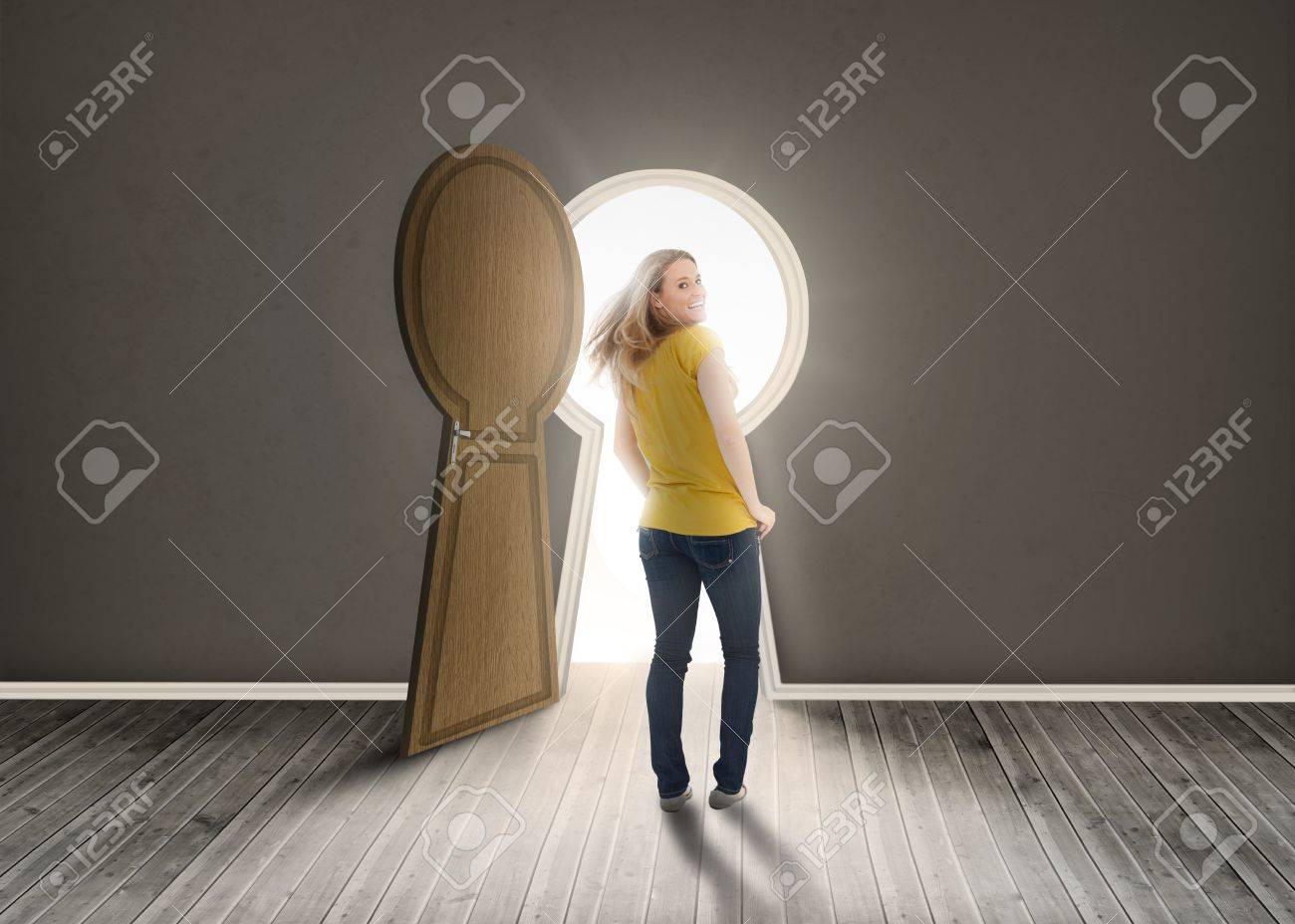 Stock Photo - Woman walking towards keyhole shaped doorway with light ikn dark grey room & Woman Walking Towards Keyhole Shaped Doorway With Light Ikn Dark ...
