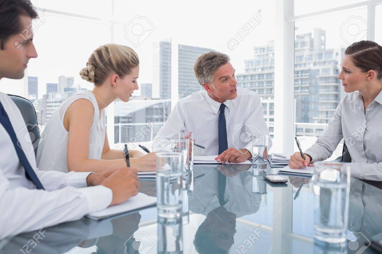 Serious businessman during a meeting talking to his employees in the meeting room Stock Photo - 20586741