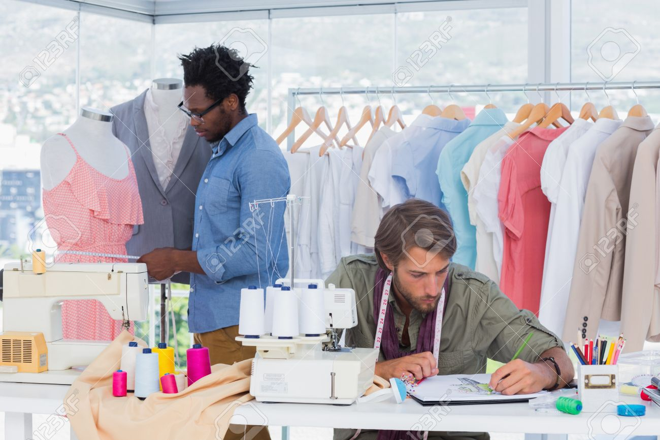 Male Interior Designers At Work team of fashion designers at work stock photo, picture and royalty
