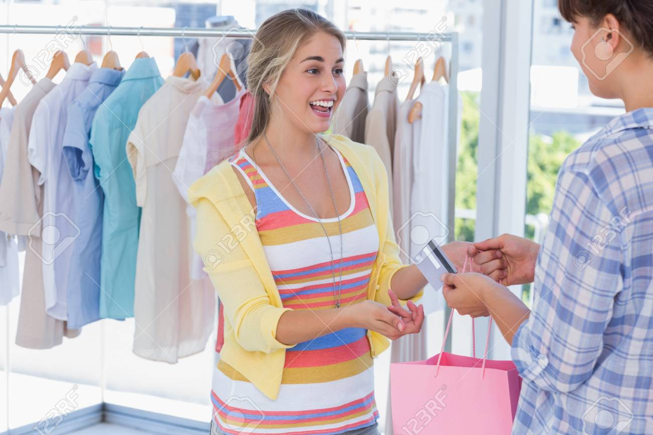 Cashier giving credit card to customer in a bright shop Stock Photo - 20592719