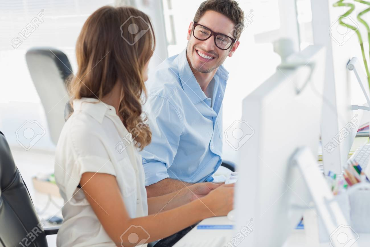 Team of photo editors working together in their office Stock Photo - 20635564