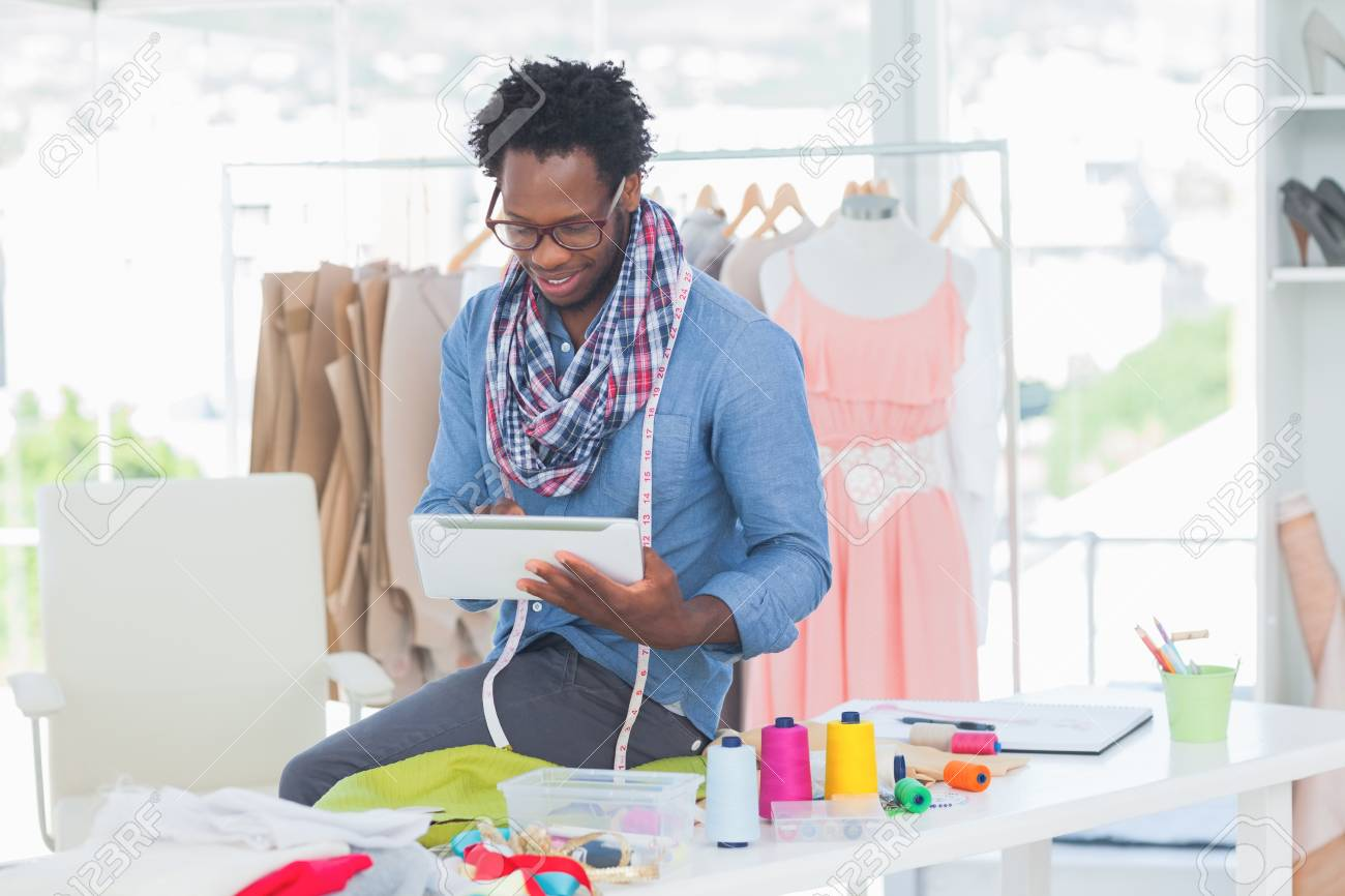 Fashion designer using digital tablet in a creative office Stock Photo - 20638899