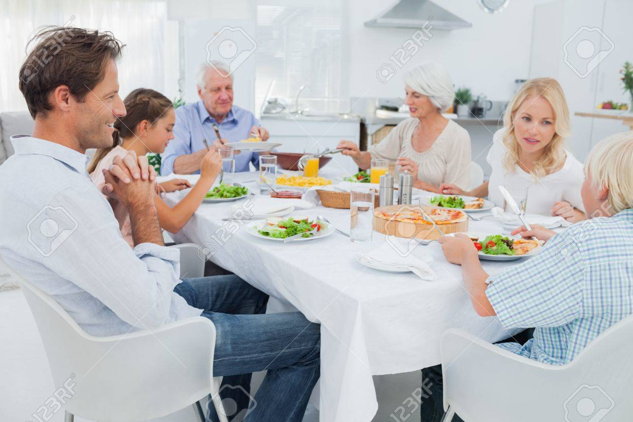 Extended family at the dinner table in kitchen Stock Photo - 20638325