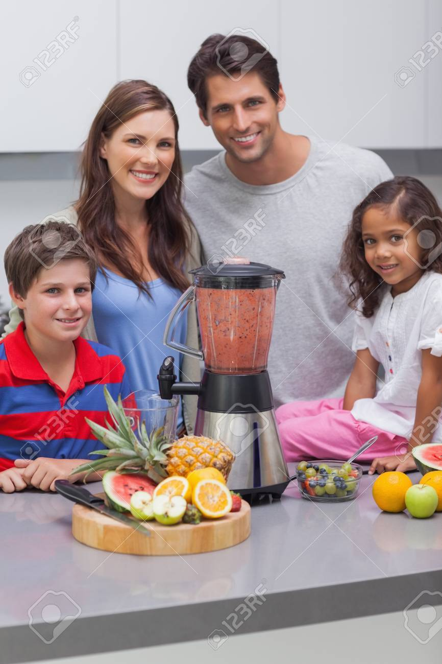 Smiling family using a blender together in the kitchen Stock Photo - 20639686