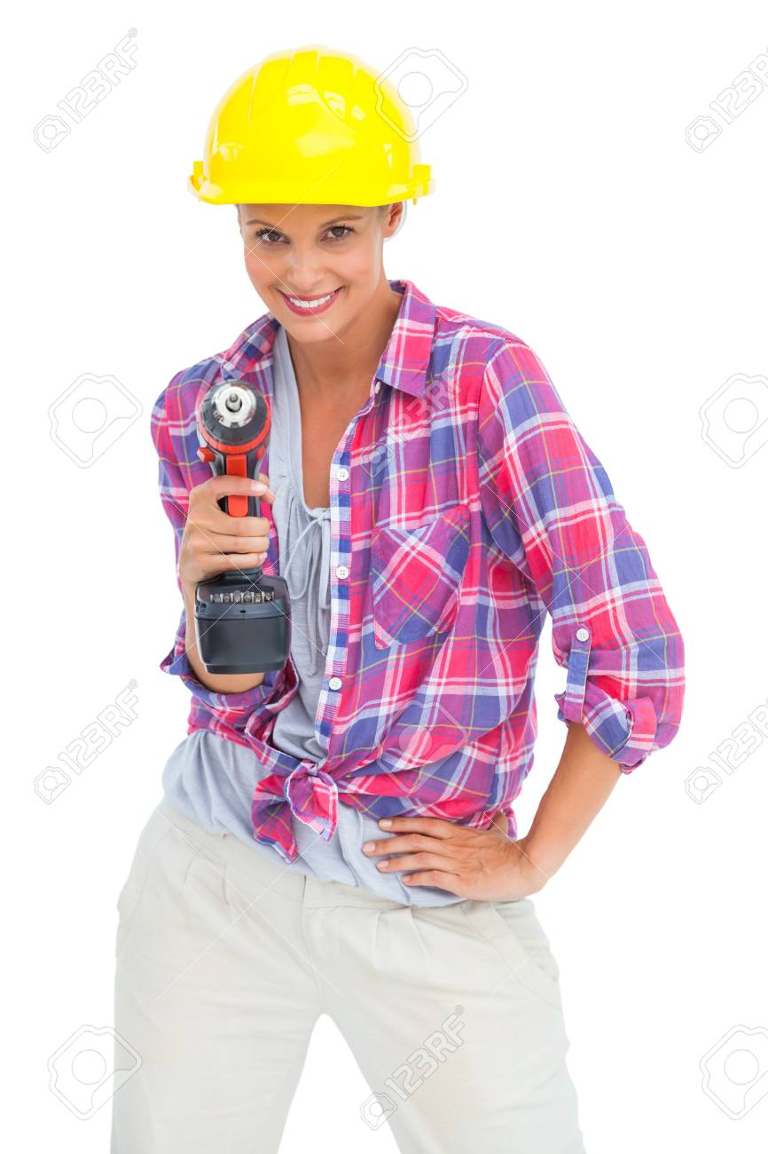 Smiling handy woman with a power drill on white background Stock Photo - 20624169