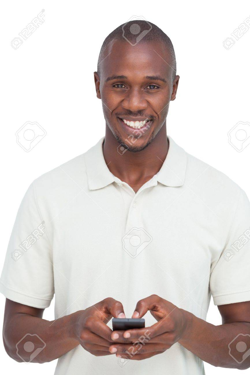 Smiling man using his mobile phone on a white background Stock Photo - 20624112