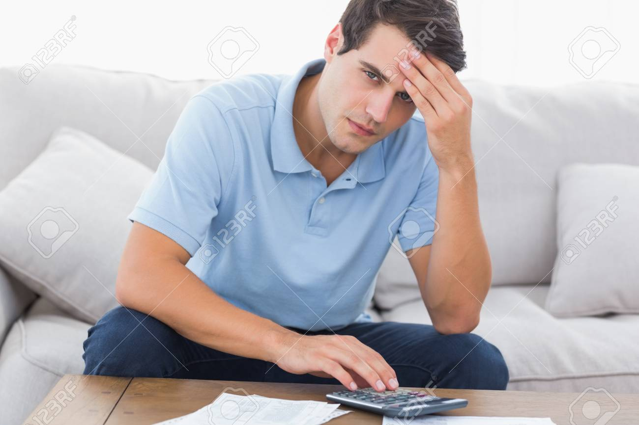 Portrait of an anxious man doing his accounts Stock Photo - 20624450