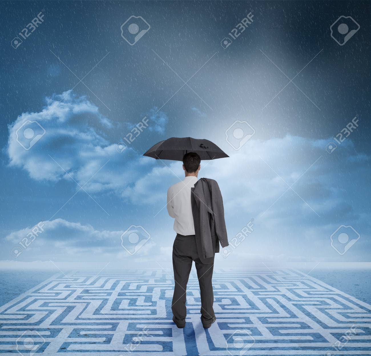 Business looking at the horizon while he is standing on a labyrinth Stock Photo - 20628600