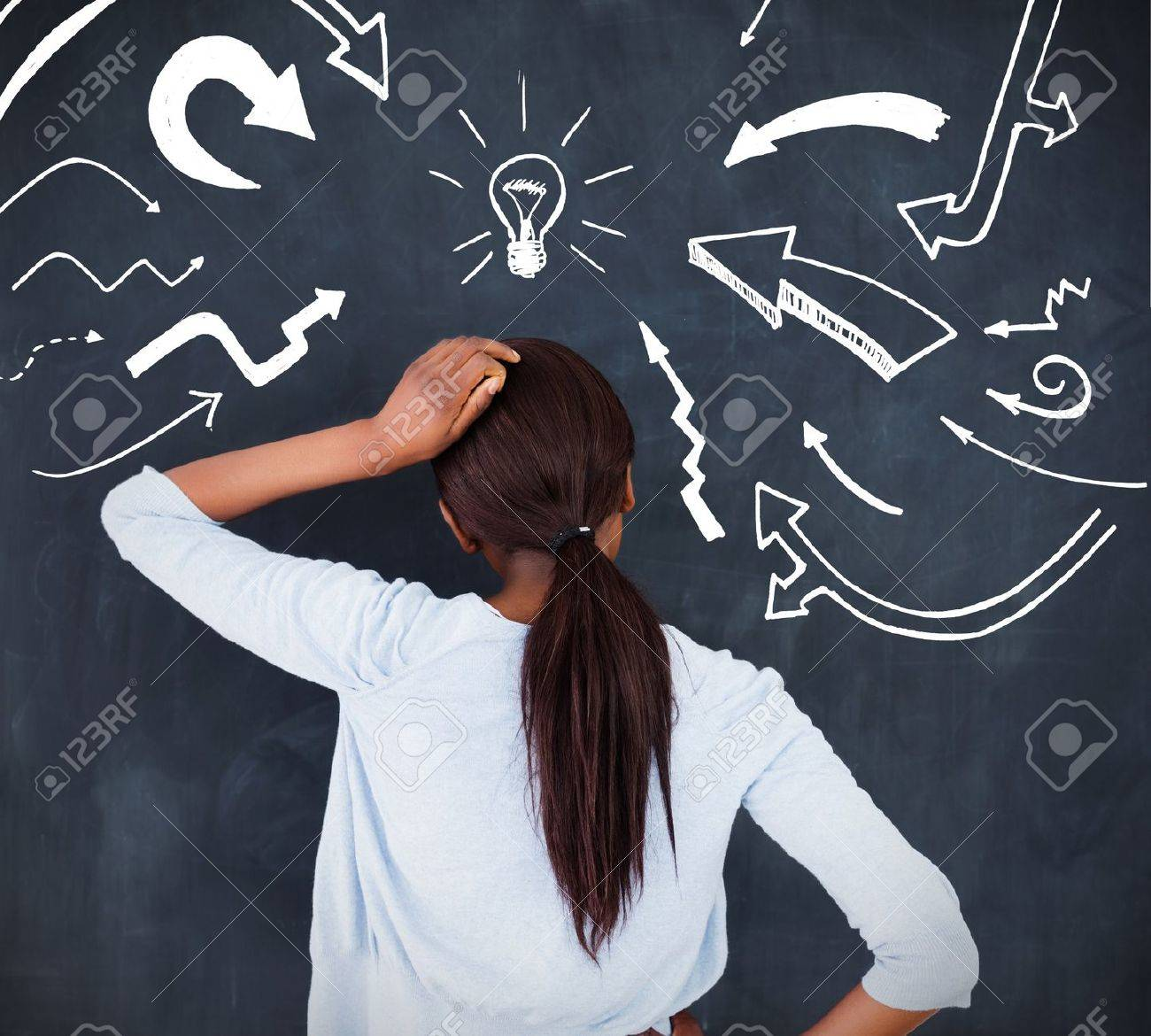 Rear view of a woman having an idea and putting her hand on her head Stock Photo - 20629347