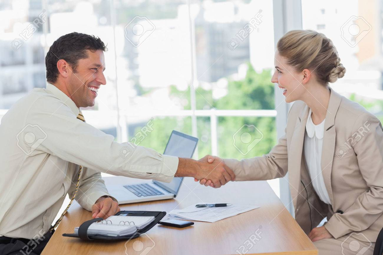 blonde w shaking hands while having an interview in office blonde w shaking hands while having an interview in office stock photo 25696530