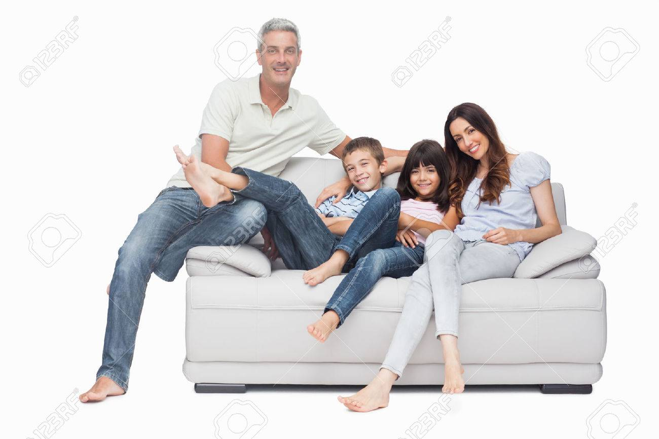 Marvelous Family Sitting On Sofa Smiling At Camera On White Background Stock Photo    25731342