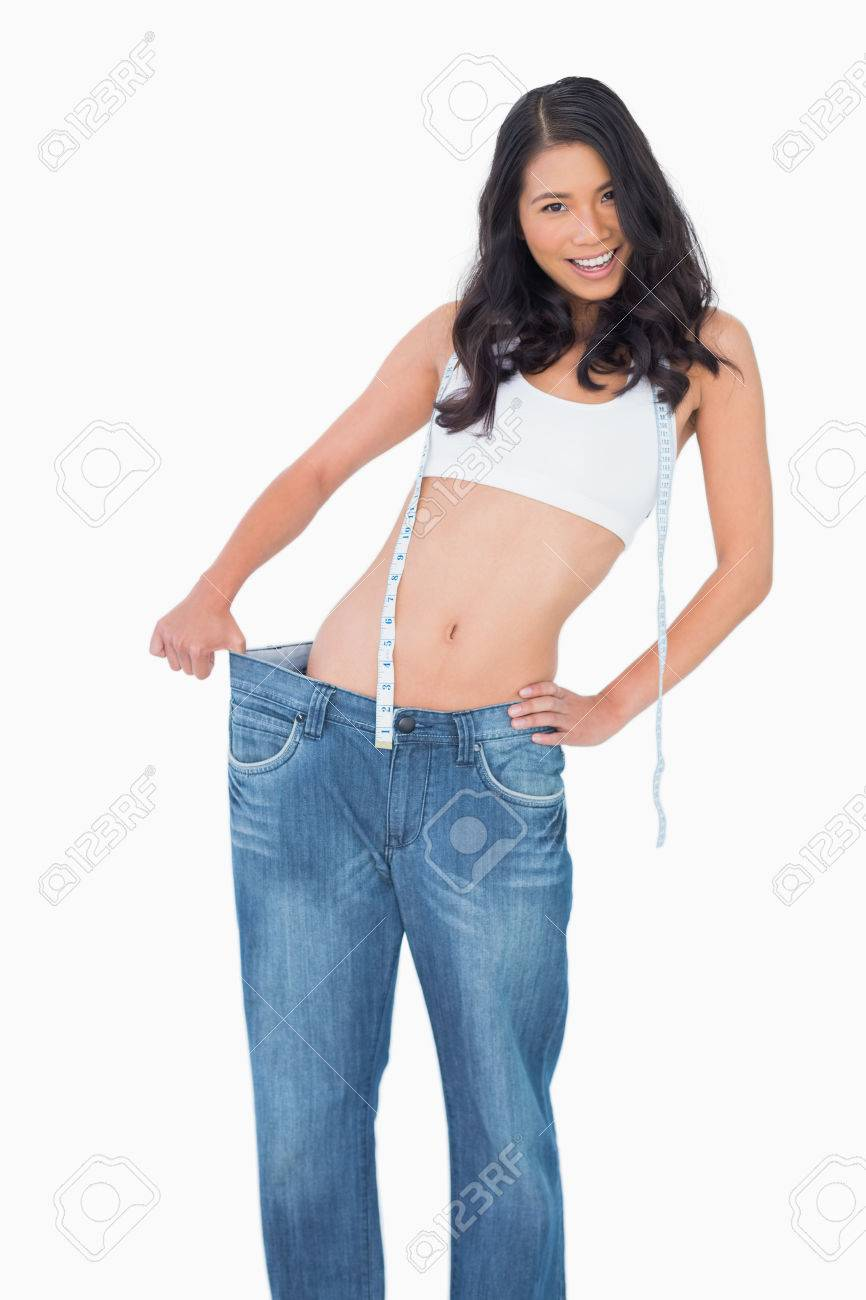 Background image too big - Smiling Sexy Woman Wearing Too Big Pants On White Background Stock Photo 25743673