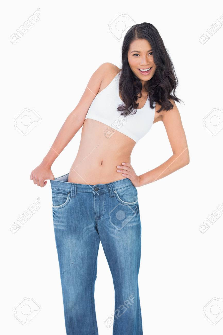 Background image too big - Smiling Sexy Woman Wearing Too Big Jeans On White Background Stock Photo 25777288