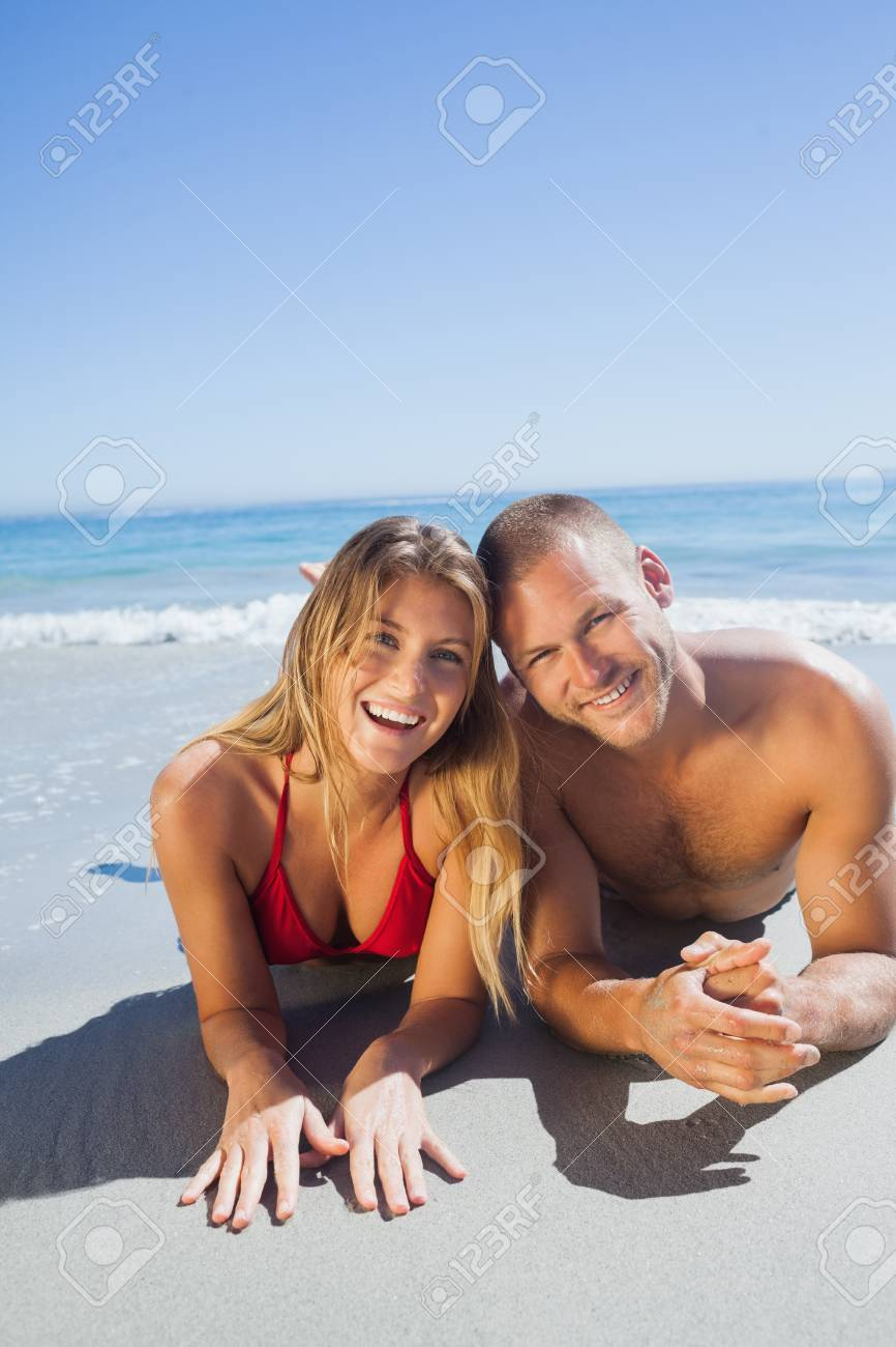 Smiling Cute Couple In Swimsuit Posing On The Beach Stock Photo Picture And Royalty Free Image Image 25765144