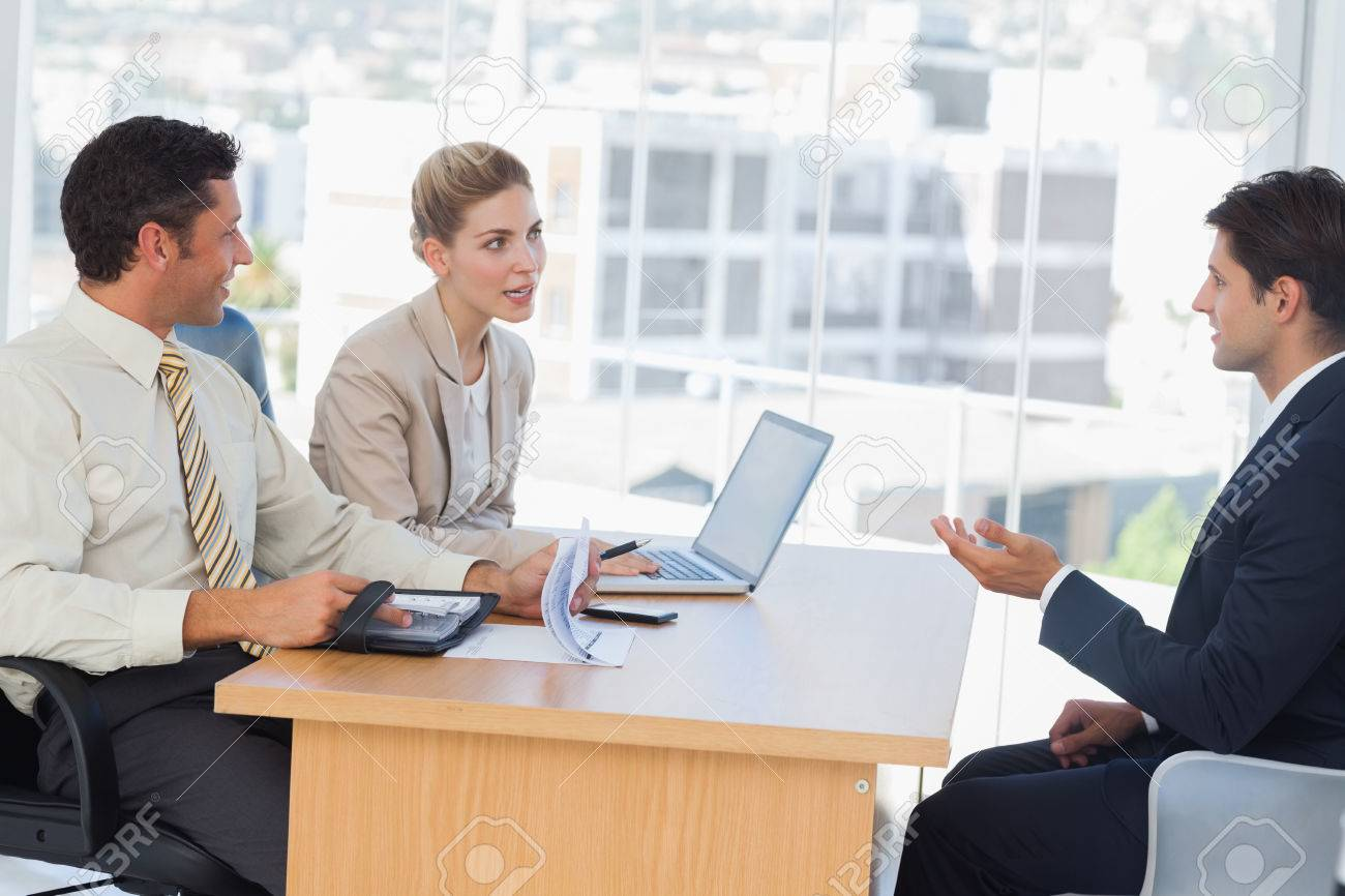 business people speaking during interview in their office stock business people speaking during interview in their office stock photo 25765276