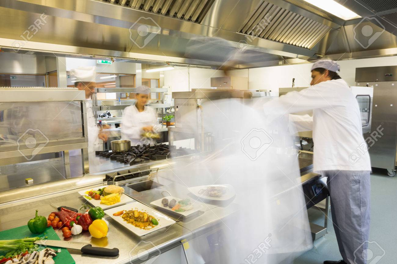 Busy Kitchen chefs busy at work in a busy kitchen stock photo, picture and