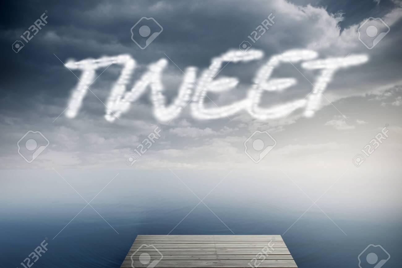 The word tweet against cloudy sky over ocean Stock Photo - 26804901