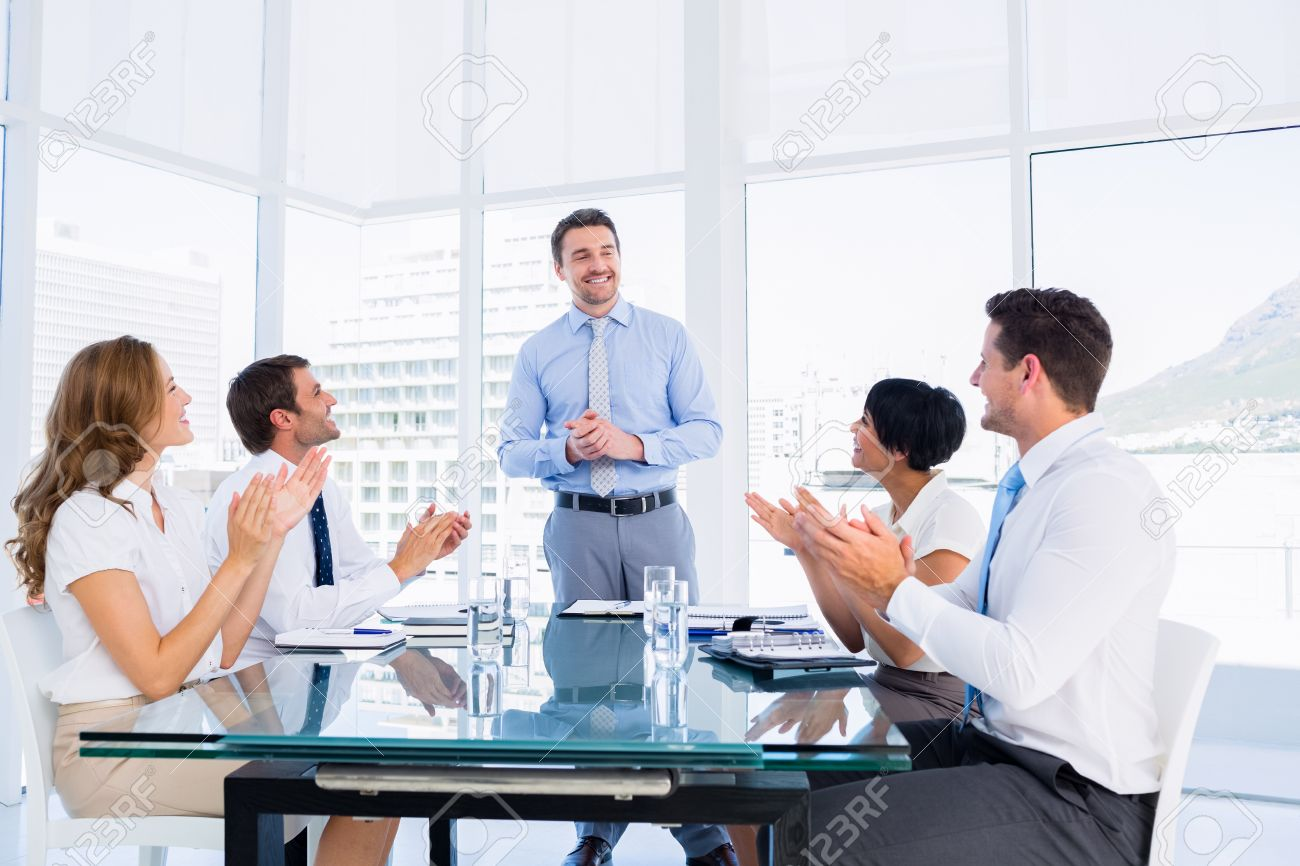 business executives clapping around conference table in a bright office stock photo 28380927 bright office