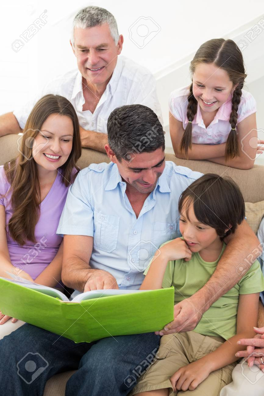 Multigeneration family reading book at home Stock Photo - 27085988
