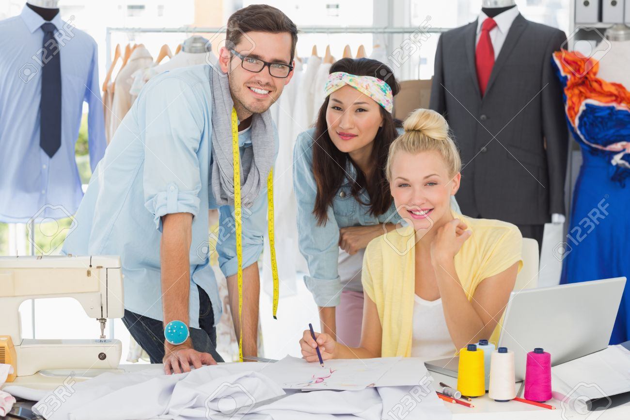 Fashion Designers At Work Group of fashion designers at