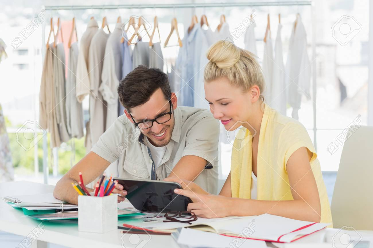 Two fashion designers using digital laptop in a studio Stock Photo - 27142974