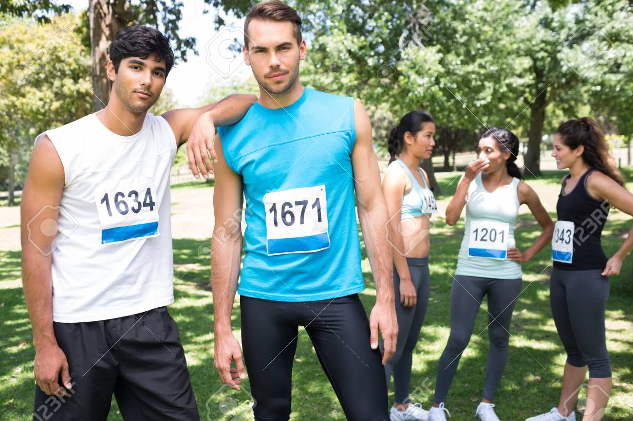 Portrait Of Male Marathon Runners At A Race In The Park Stock Photo