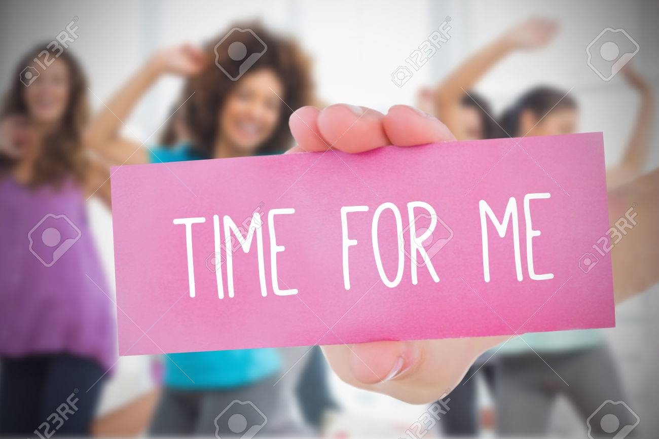 Woman holding pink card saying time for me against dance class in gym - 28968804