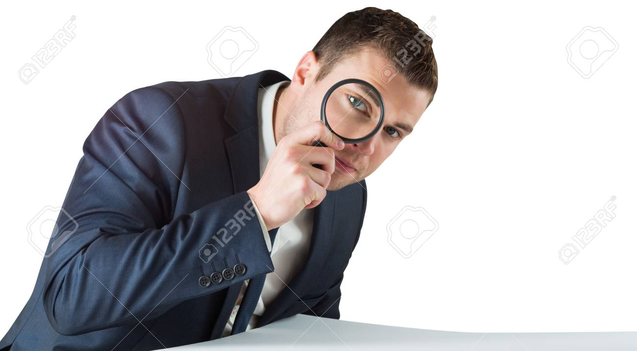 Businessman looking through magnifying glass on white background Stock Photo - 29054411