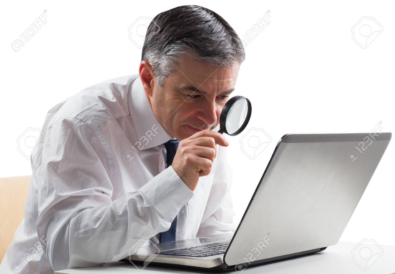 Mature businessman examining with magnifying glass on white background Stock Photo - 29056145