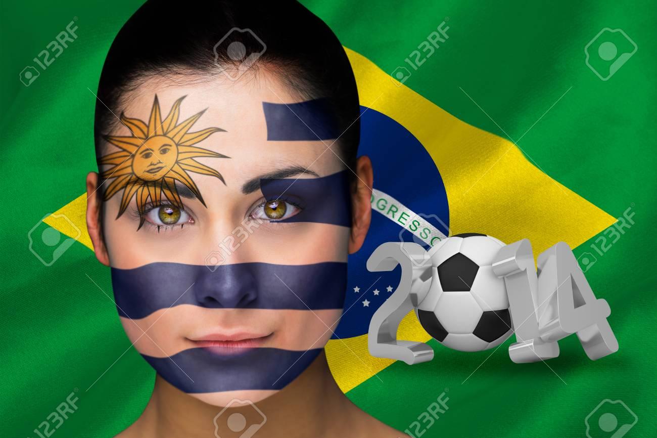 Composite Bild Von Uruguay Fussball Fan Im Gesicht Malen Gegen Wm 2014 Mit Brasilien Flaggen
