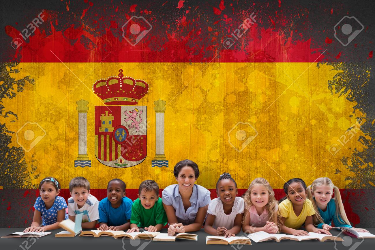 Grunge Camera Effect : Cute pupils smiling at camera with teacher against spain flag