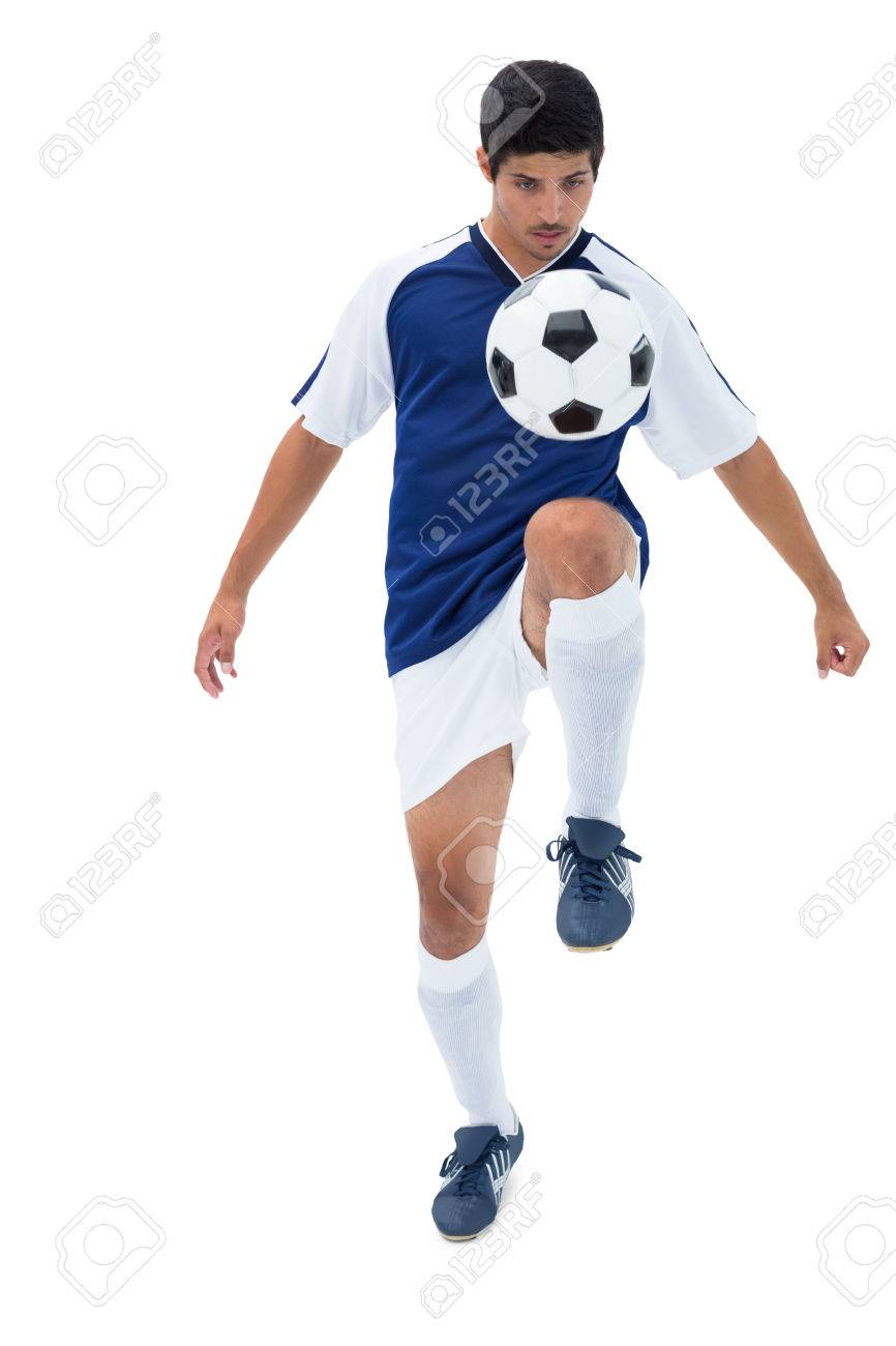 e667914e5 Football player in blue kicking ball on white background Stock Photo -  30923276