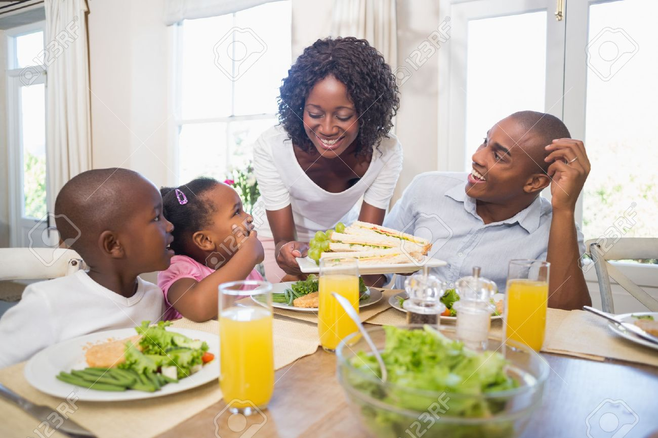 Happy family in kitchen - Happy Family Enjoying A Healthy Meal Together At Home In The Kitchen Stock Photo 30926828