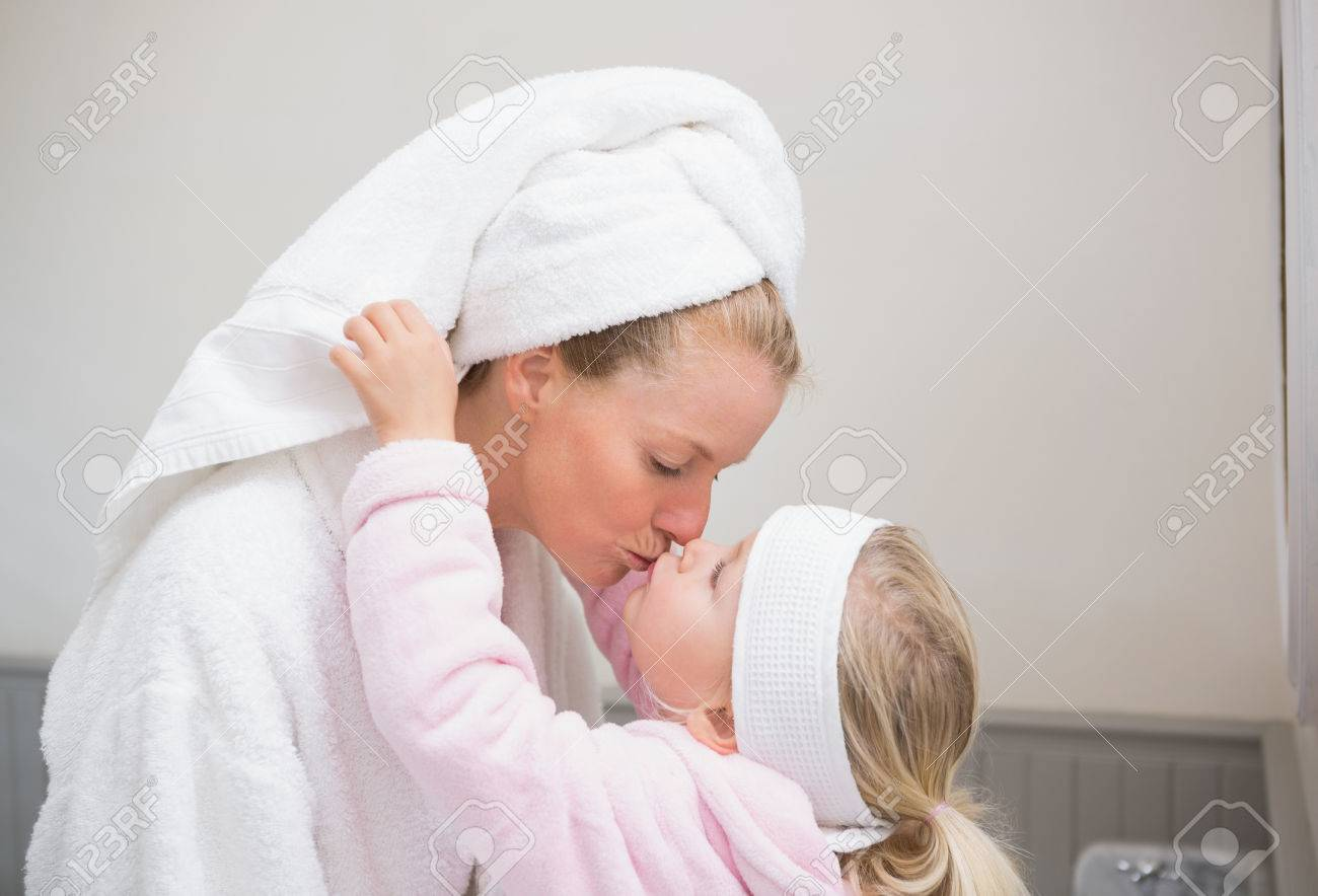 bcae39526a Cute little girl with mother in bathrobes at home in the bathroom Stock  Photo - 31374347
