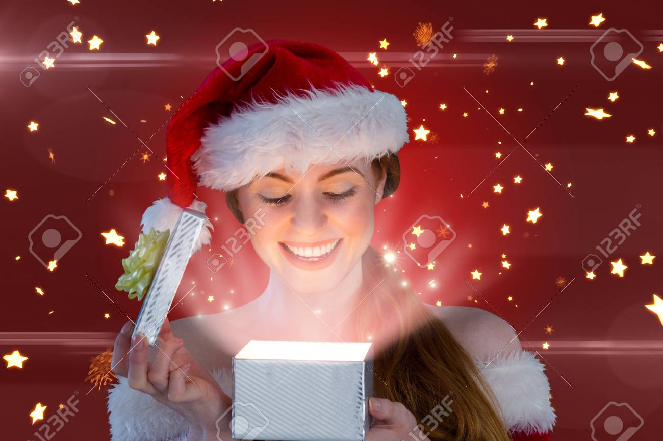 girl in santa costume opening a gift against bright star pattern on red Stock Photo -  sc 1 st  123RF.com & Girl In Santa Costume Opening A Gift Against Bright Star Pattern ...