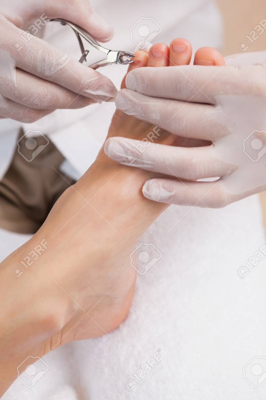 Salon Worker Using A Nail Clippers On Customers Toe Nails Stock ...