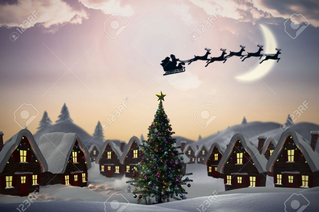 Silhouette Of Santa Claus And Reindeer Against Cute Christmas Village With Tree Stock Photo