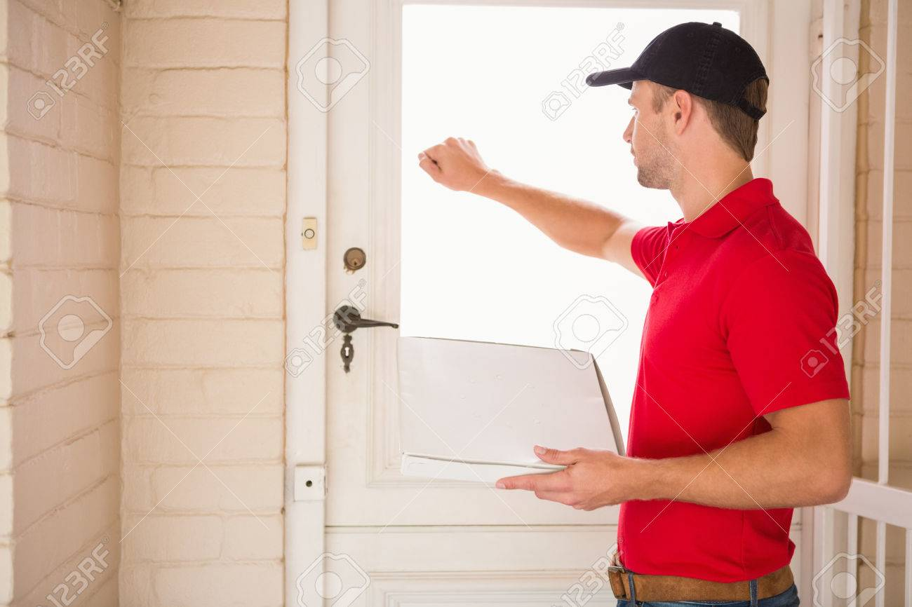 delivery door: Delivery man holding pizza while knocking on the door to a house & Delivery Door Images \u0026 Stock Pictures. Royalty Free Delivery Door ... Pezcame.Com