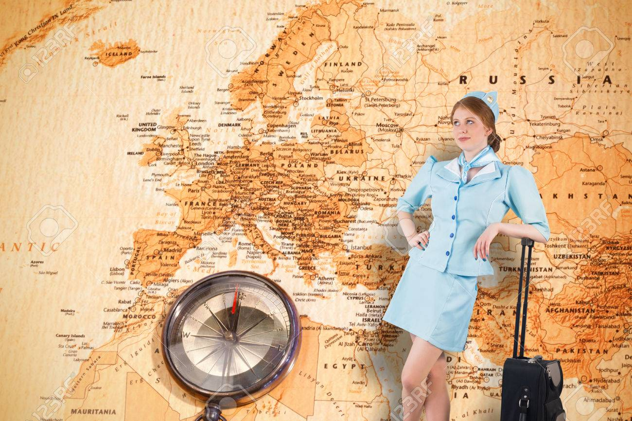 Pretty air hostess leaning on suitcase against world map with pretty air hostess leaning on suitcase against world map with compass showing europe and the middle gumiabroncs Gallery
