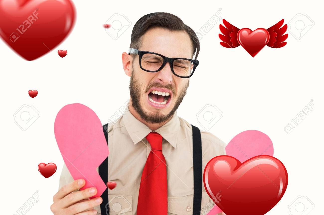 Inconformista Geeky Llorando Y Sosteniendo La Tarjeta De Corazón
