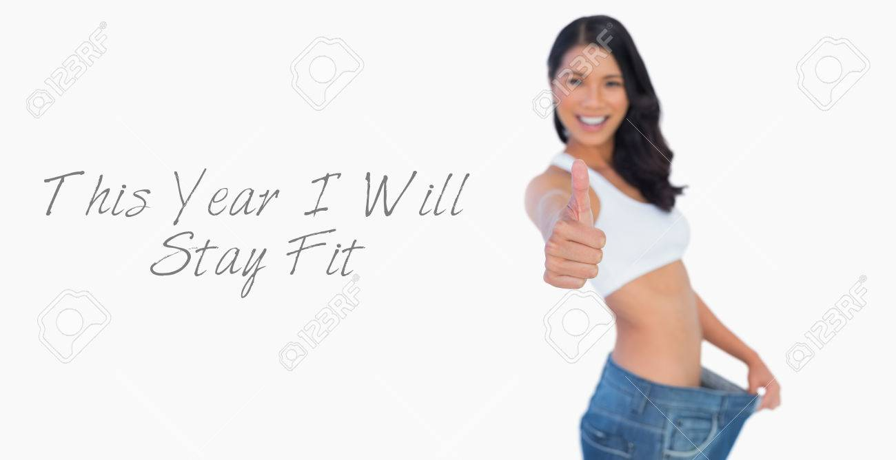 Background image too big - Stock Photo Victorious Woman Holding Her Too Big Pants Thumbs Up On White Background