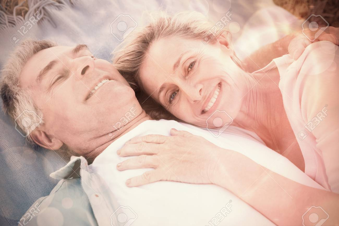 Happy Senior Couple Cuddling On Blanket A Sunny Day Stock Photo