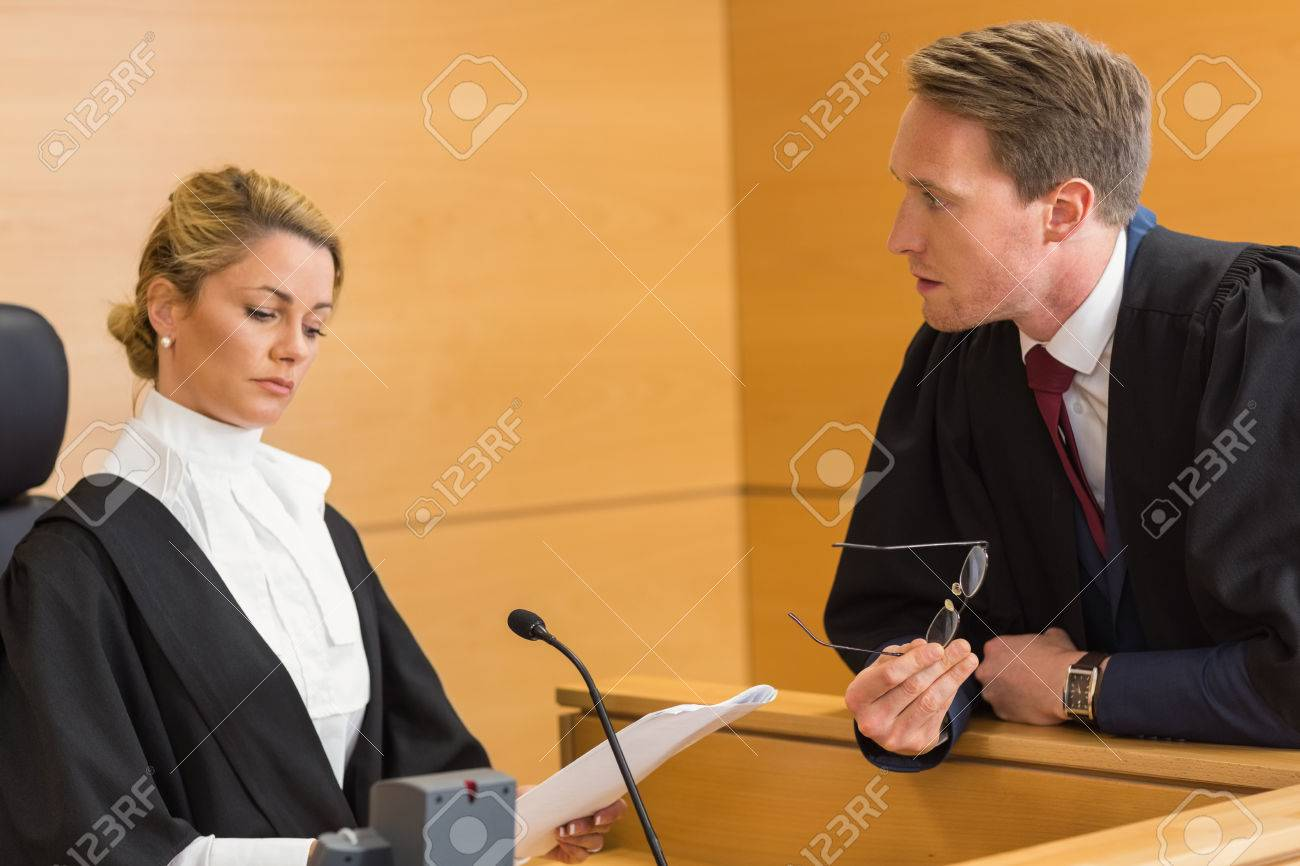 Lawyer speaking with the judge in the court room - 36415941