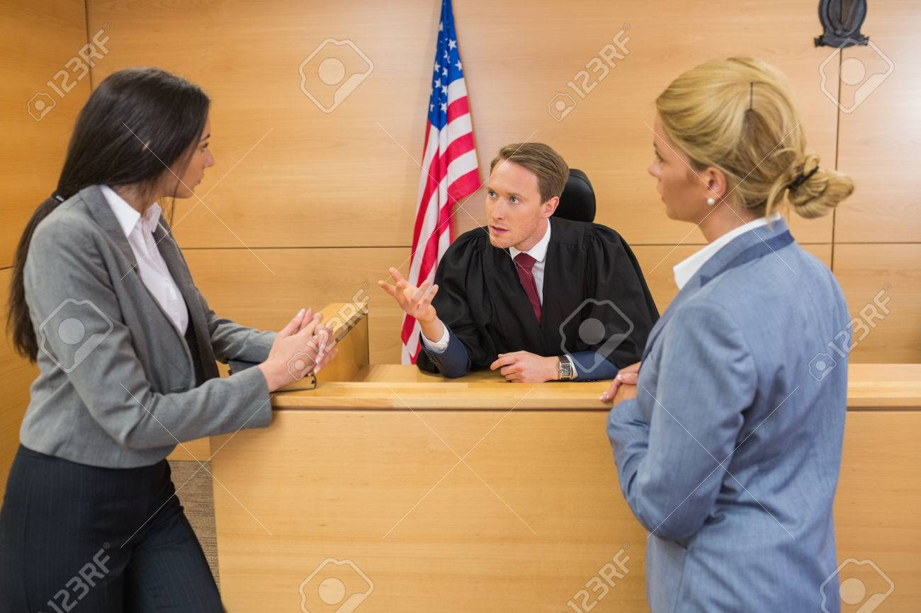 Lawyers speaking with the judge in the court room - 36415969